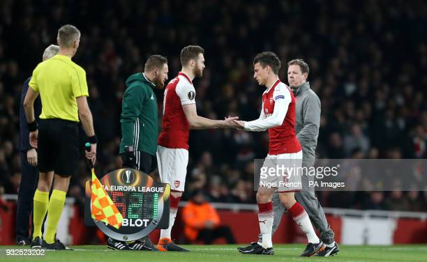 Arsenal's Laurent Koscielny leaves the field after picking up an injury ad is substituted for Calum Chambers during the UEFA Europa League round of...