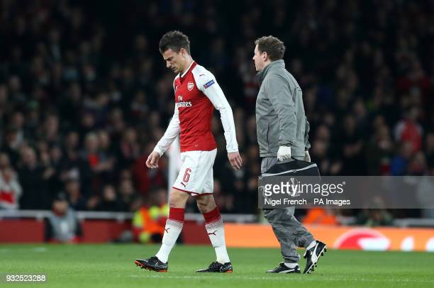 Arsenal's Laurent Koscielny leaves the field after picking up an injury during the UEFA Europa League round of 16 second leg match at the Emirates...