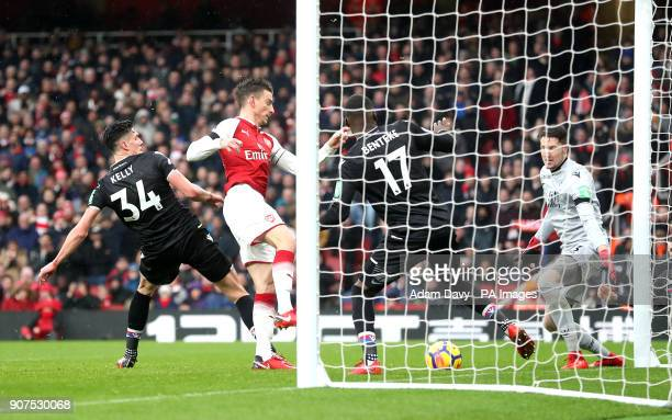 Arsenal's Laurent Koscielny scores his side's third goal of the game during the Premier League match at the Emirates Stadium London