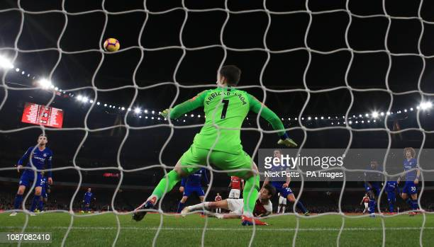 Arsenal's Laurent Koscielny scores the second goal beating Chelsea goalkeeper Kepa Arrizabalaga during the Premier League match at The Emirates...