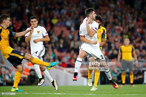 Arsenals Laurent Koscielny vies with Basel's Andraz Sporar during Champions League Group A match between Arsenal FC and FC Basel at Emirates Stadium...