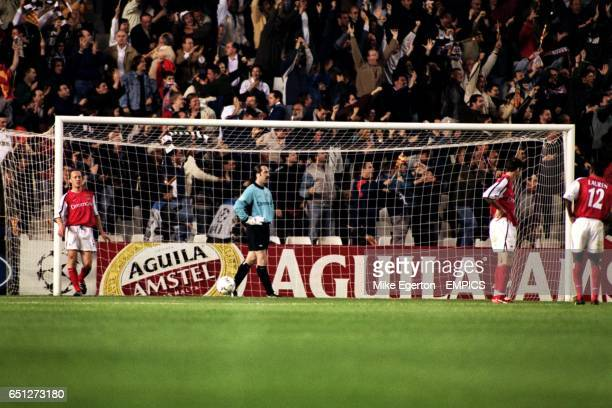 Arsenal's Lee Dixon David Seaman Martin Keown and Lauren stand rooted in dejection as the Valencia fans behind the goal celebrate the winning goal