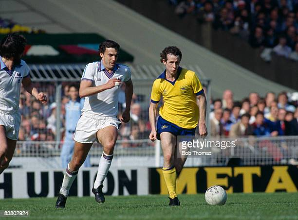 Arsenal's Liam Brady is chased by West Ham United's Trevor Brooking during the FA Cup Final at Wembley Stadium 10th May 1980 West Ham United won 10