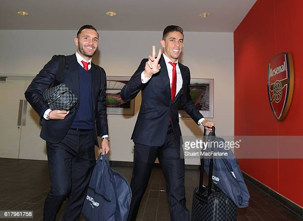 Arsenal's Lucas Perez and Gabriel arrive before the EFL Cup Fourth Round match between Arsenal and Reading at Emirates Stadium on October 25 2016 in...