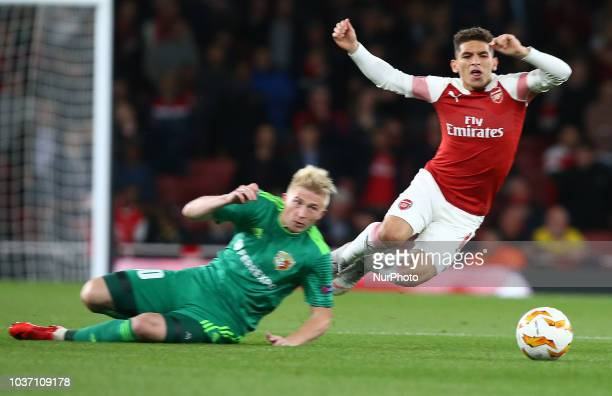 Arsenal's Lucas Torreira gets tackled by Vladyslav Kulach of FC Vorskla Poltava during UAFA Europa League Group E between Arsenal and FC Vorskla...