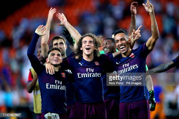 Arsenal's Lucas Torreira Matteo Guendouzi and PierreEmerick Aubameyang celebrate the results at the end of the UEFA Europa League Semi Final Second...