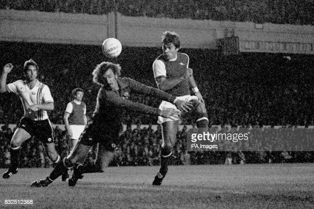 Arsenal's Malcolm MacDonald knocks the ball past Manchester United goalkeeper Alex Stepney to score the opening goal watched by United's Martin Buchan