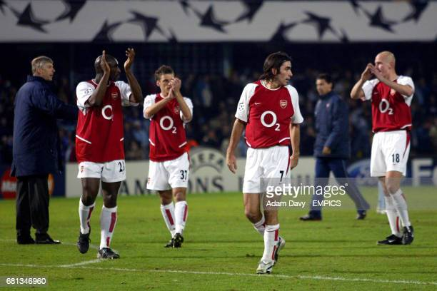 Arsenal's manager Arsene Wenger Sol Campbell David Bentley Robert Pires and Pascal Cygan applaud the travelling fans