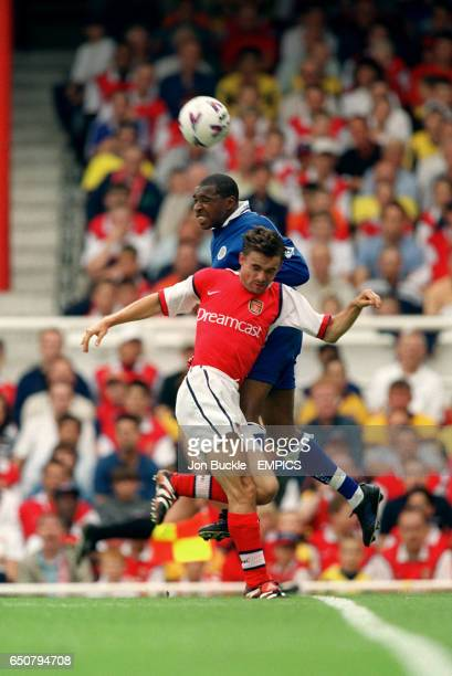 LR Arsenal's Marc Overmars is beaten to a header by Leicester City's Andrew Impey