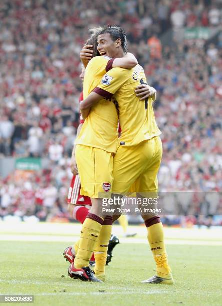 Arsenal's Marouane Chamakh celebrates after his shot hit the post and bounced of Liverpool goalkeeper Jose Reina for his sides first goal during the...