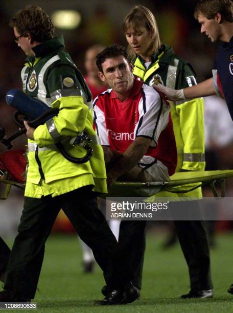 Arsenal's Martin Keown is stretchered off in the first half of the UEFA Champions League match against Shakhtar Donetsk's at Highbury in London 20...