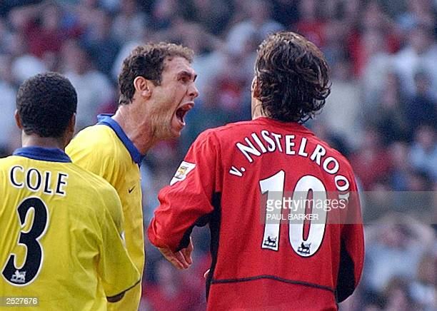 Arsenal's Martin Keown taunts Manchester United's Ruud Van Nistelrooy after he missed a penalty given away by Keown in the final minutes of todays...