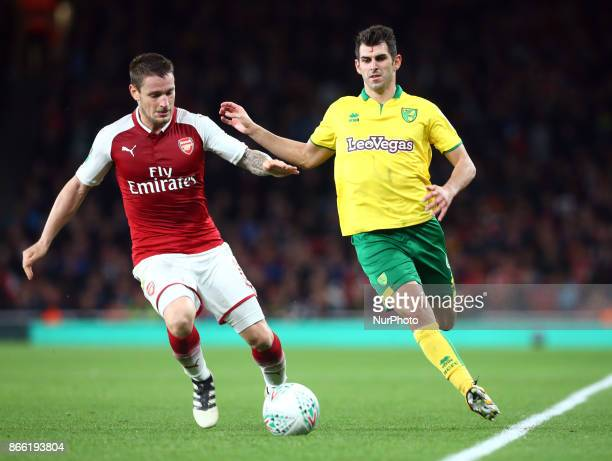 LR Arsenal's Mathieu Debuchy and Nelson Oliveira of Norwich City during Carabao Cup 4th Round match between Arsenal and Norwich City at Emirates...