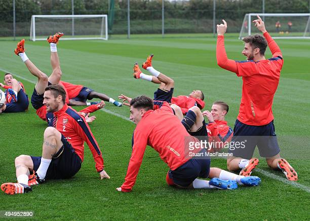 Arsenal's Mathieu Debuchy Hector Bellerin and Olivier Giroud before a training session at London Colney on October 30 2015 in St Albans England