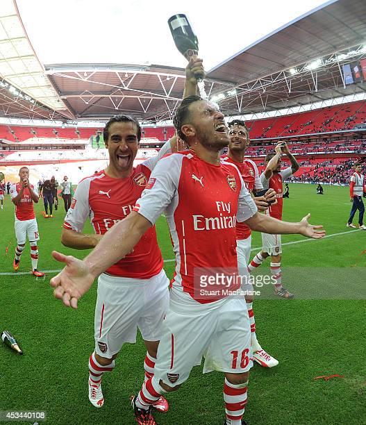 Arsenal's Mathieu Flamini and Aaron Ramsey celebrate after the FA Community Shield match between Arsenal and Manchester City at Wembley Stadium on...