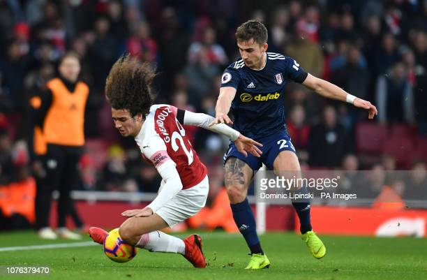 Arsenal's Matteo Guendouzi and Fulham's Joe Bryan battle for the ball during the Premier League match at the Emirates Stadium London