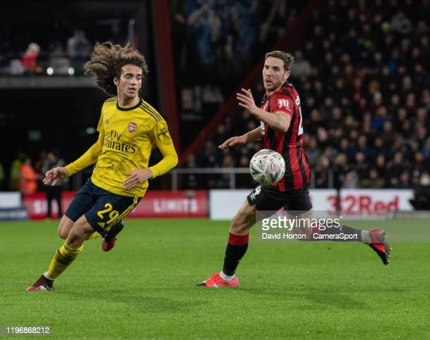 Arsenal's Matteo Guendouzi holds off the challenge from Bournemouth's Dan Gosling during the FA Cup Fourth Round match between Bournemouth and...