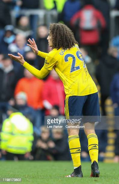 Arsenal's Matteo Guendouzi indicates he is playing rugby after receiving abuse from the Burnley fans during the Premier League match between Burnley...