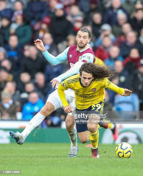 Arsenal's Matteo Guendouzi is fouled by Burnley's Jay Rodriguez during the Premier League match between Burnley FC and Arsenal FC at Turf Moor on...