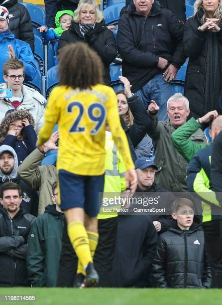 Arsenal's Matteo Guendouzi is taunted by Burnley fans as he leaves the pitch at the end of the match during the Premier League match between Burnley...