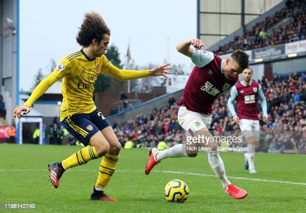 Arsenal's Matteo Guendouzi vies for possession with Burnley's Ashley Westwood during the Premier League match between Burnley FC and Arsenal FC at...