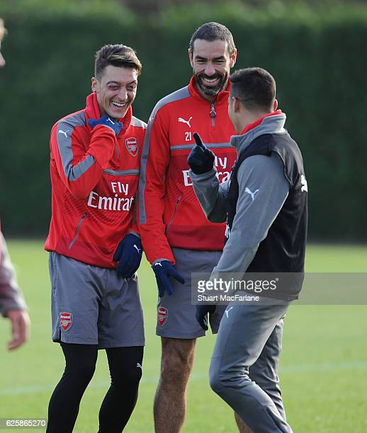 Arsenal's Mesut Ozil and Alexis Sanchez with ex player Robert Pires during a training session in preparation for the Premier League match against AFC...