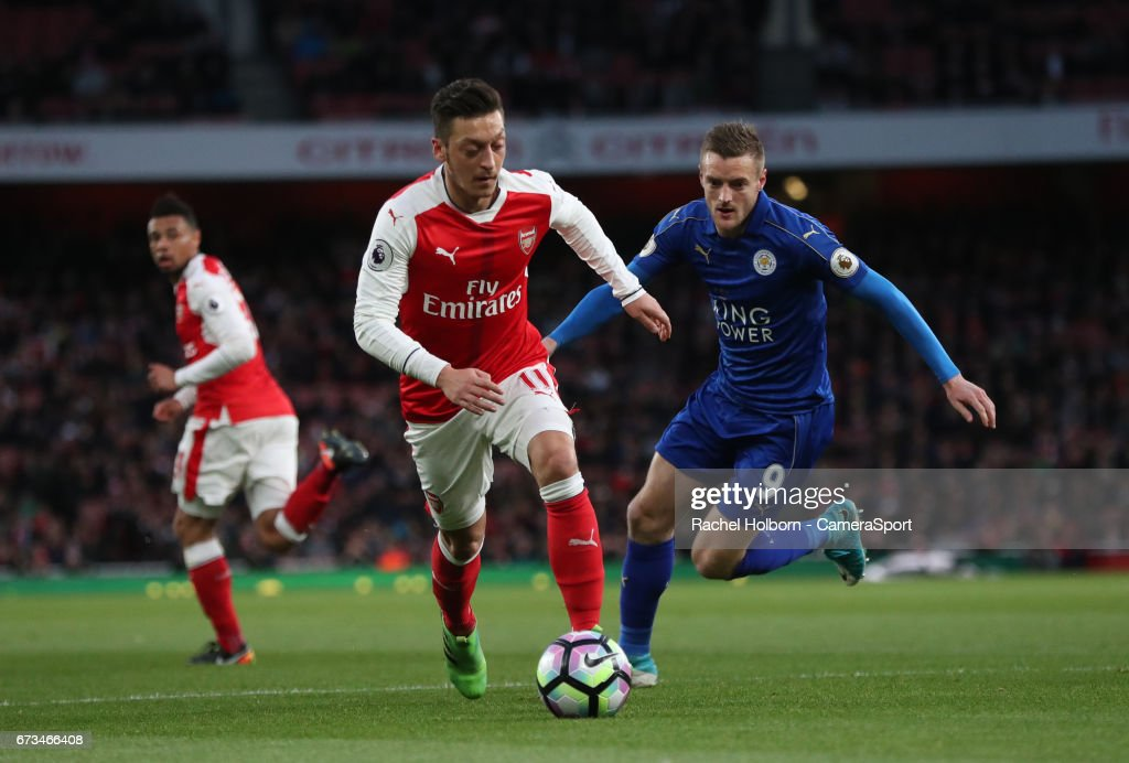 Arsenal's Mesut Ozil and Leicester City's Jamie Vardy during the Premier League match between Arsenal and Leicester City at Emirates Stadium on April 26, 2017 in London, England.