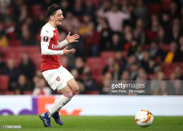 Arsenal's Mesut Ozil appears dejected after failing to collect the ball during the UEFA Europa League round of 32 second leg match at the Emirates...