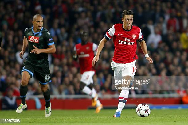 Arsenal's Mesut Ozil in action during the UEFA Champions League Group F soccer match between Arsenal FC and SSC Napoli at Emirates Stadium on October...