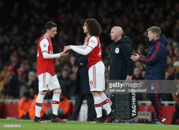 Arsenal's Mesut Ozil is substituted for Matteo Guendouzi during the Premier League match between Arsenal FC and Everton FC at Emirates Stadium on...