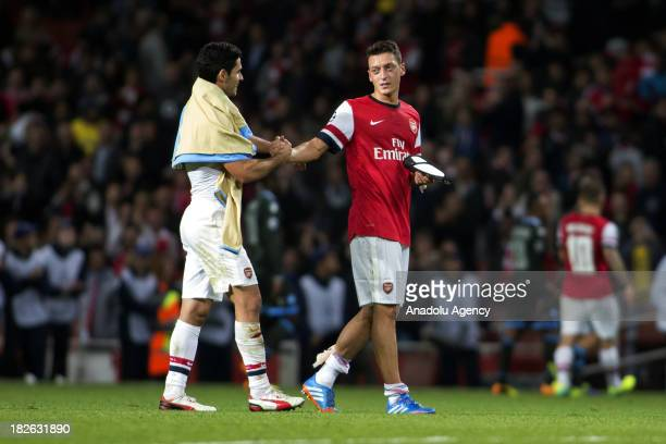 Arsenal's Mesut Ozil leaves the pitch after the UEFA Champions League Group F soccer match between Arsenal FC and SSC Napoli at Emirates Stadium on...