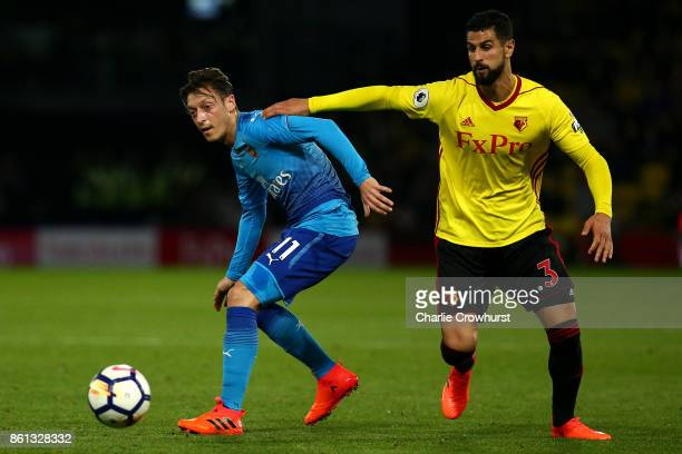 Arsenal's Mesut Ozil looks to hold the ball up from Watford's Miguel Britos during the Premier League match between Watford and Arsenal at Vicarage...