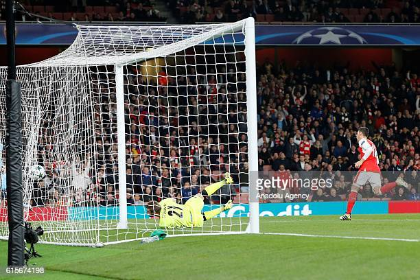 Arsenals Mesut Özil scores the forth goal during Champions League Group A match between Arsenal FC and Ludogorets Razgrad at Emirates Stadium on...