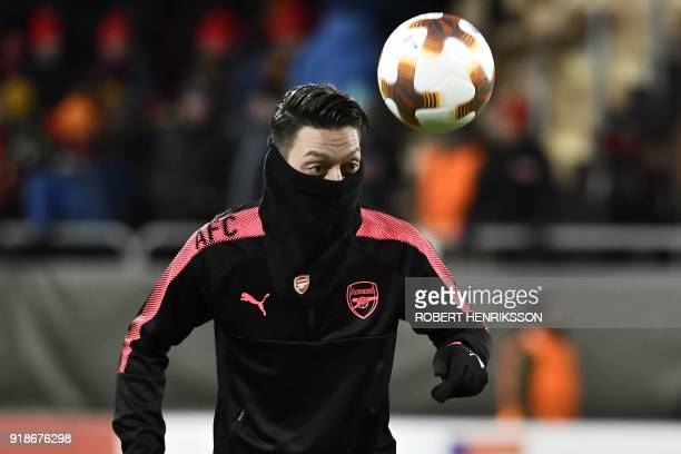 Arsenal's Mesut Özil warms up with the ball prior to the UEFA Europa League round of 32 first leg football match of Ostersund FK vs Arsenal FC on...