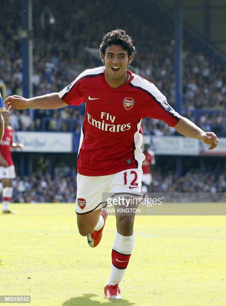 Arsenal's Mexican striker Carlos Vela celebrates scoring his goal during the Premier League football match between Portsmouth and Arsenal at Fratton...