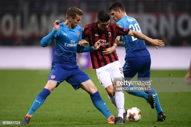 Arsenal's midfielder Aaron Ramsey of Wales fights for the ball with AC Milan's forward Andre Silva from Portugal during the UEFA Europa League round...