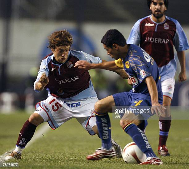 Arsenal's midfielder Alejandro Gomez vies for the ball with FC America's defender Oscar Rojas during the Copa Sudamericana finals at Racing Club...