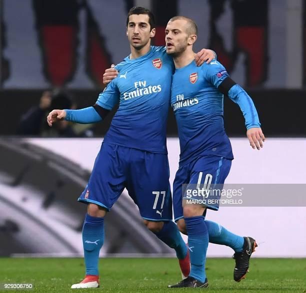 Arsenal's midfielder Henrikh Mkhitaryan of Armenia celebrates after scoring with Arsenal's midfielder Jack Wilshere of England during the UEFA Europa...