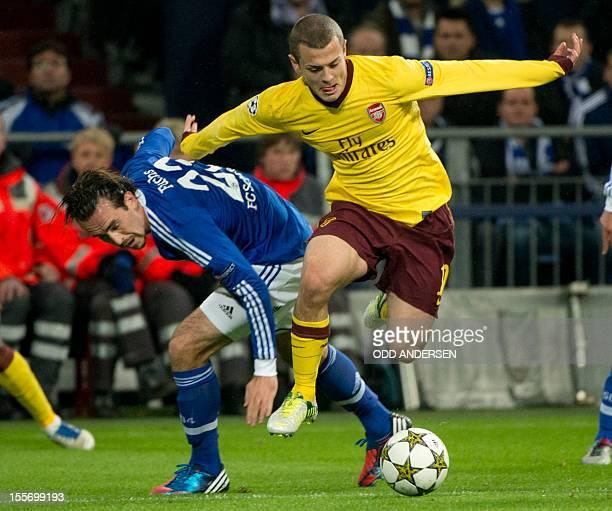 Arsenal´s midfielder Jack Wilshere and Schalke's Austrian defender Christian Fuchs vie for the ball during the UEFA Champions league group B football...