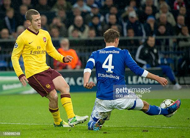 Arsenal´s midfielder Jack Wilshere and Schalke's defender Benedikt Hoewedes vie for the ball during the UEFA Champions league group B football match...