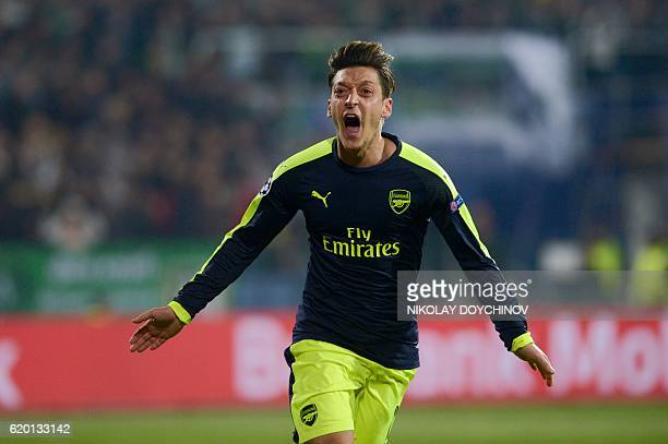Arsenals midfielder Mesut Özil celebrates after scoring a goal during the UEFA Champions League Group A football match between PFC Ludogorets and...