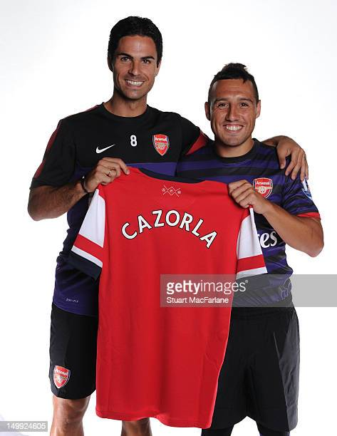Arsenal's Mikel Arteta poses with new signing Santi Cazorla at Arsenal's Training Ground London Colney on August 6 2012 in St Albans England