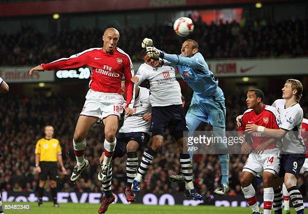 Arsenal's Mikel Silvestre heads a goal to make it 11 against Tottenham Hotspur as goalkeeper Gomes tries to punch clear during their Premiership...