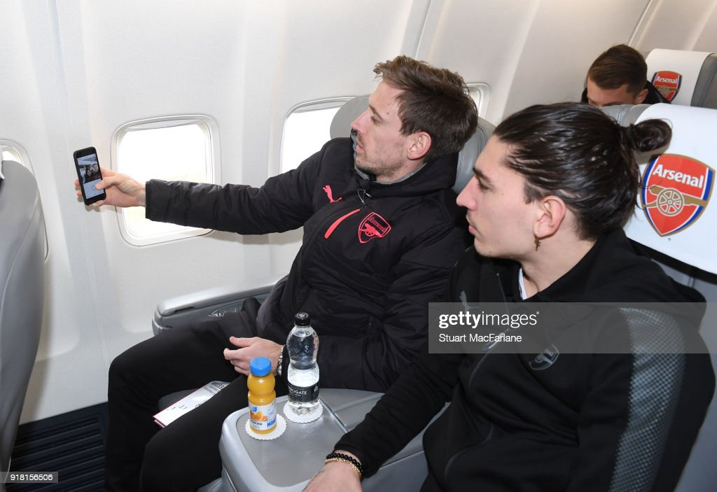 Arsenal's Nacho Monreal and Hector Bellerin on the team flight at Luton Airport on February 14, 2018 in Luton, United Kingdom.