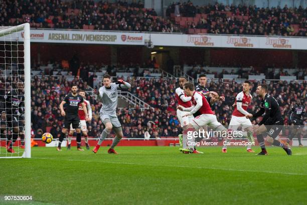 Arsenal's Nacho Monreal scores the opening goal during the Premier League match between Arsenal and Crystal Palace at Emirates Stadium on January 20...