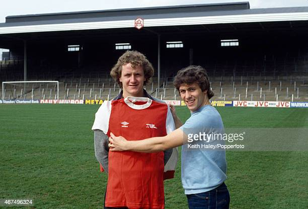 Arsenal's new signing Peter Nicholas is welcomed to Highbury by Kenny Sansom both players having previously played for Crystal Palace circa March 1981