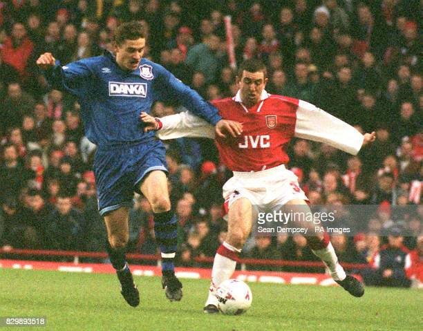 Arsenal's Nigel Winterburn attempts to fend off a challenge for the ball from Everton's Andrei Kanchelskis during this afternoon's Premier League...