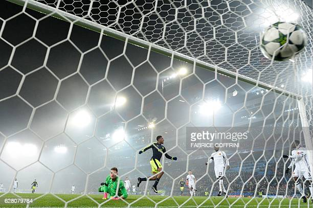 TOPSHOT Arsenal's Nigerian forward Alex Iwobi scores a goal despite of Basel's Czech goalkeeper Tomas Vaclik during the UEFA Champions league Group A...
