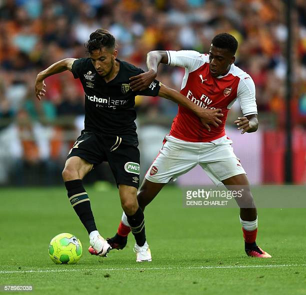 Arsenal's Nigerian forward Alex Iwobi vies with Serbian Lens's defender Dusan Cvetinovic during the football match Lens Vs Arsenal on July 22 2016 at...