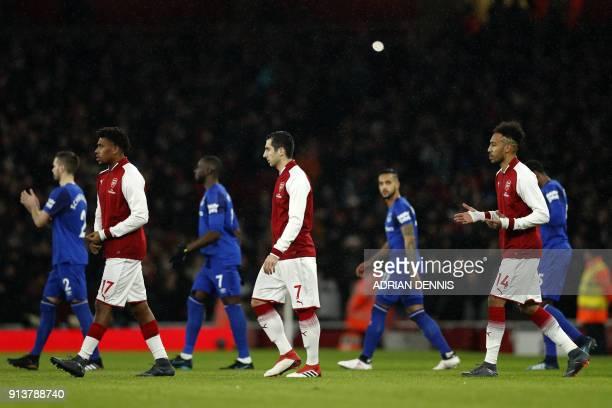 Arsenal's Nigerian striker Alex Iwobi Arsenal's Armenian midfielder Henrikh Mkhitaryan and Arsenal's Gabonese striker PierreEmerick Aubameyang walk...
